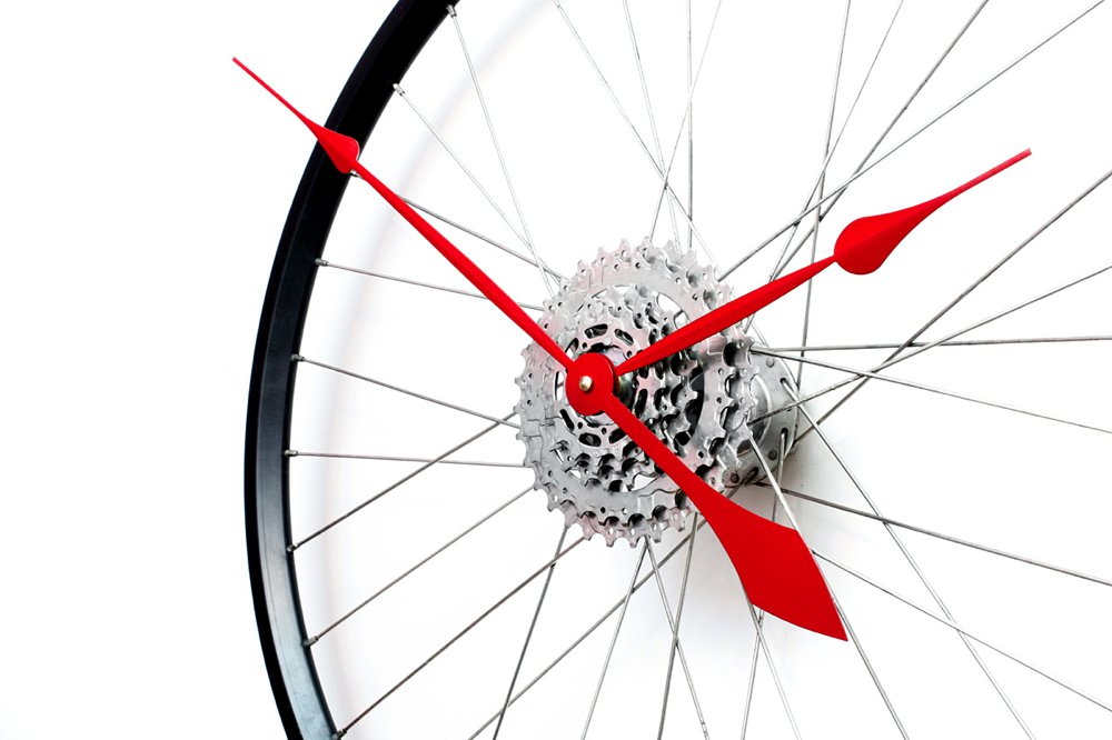 tread-and-pedals-bicycle-wheel-clock-close