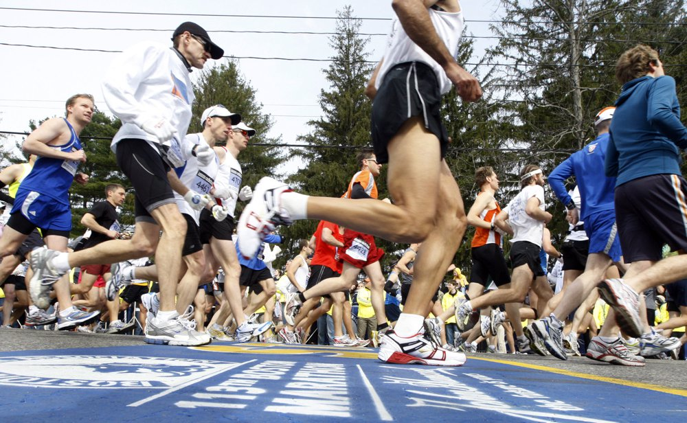 Runners cross the start line of the 113th Boston Marathon in Hopkinton, Mass., Monday, April 20, 2009. More than 26,000 runners participated in today's race. (AP Photo/Bizuayehu Tesfaye)