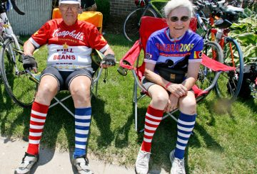 Carter LeBeau and his wife Kaye take a break in Brighton. Carter has ridden on every RAGBRAI and this is Kaye's 14th ride. M0725RAGBRAI - RAGBRAI 2009 Friday's ride took the riders from Ottumwa to Mount Pleasant. 75.5 miles through the towns of Hedrick, Martinsburg Pekin, Packwood, Pleasant Plain, Brighton, Germanville, and Lockridge.  (Andrea Melendez/The Register)
