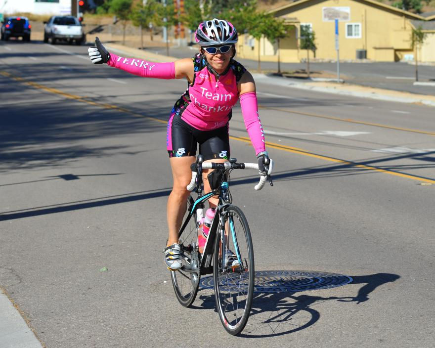 female cyclist thumbs up