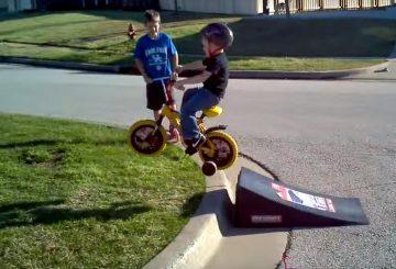 kid with helper wheels jupms ramp