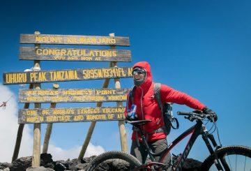 Rebecca Rusch celebrates reaching the summit of  Mount Kilimanjaro, Tanzania on 24 February, 2016.