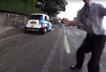 taxi driver assault to biker