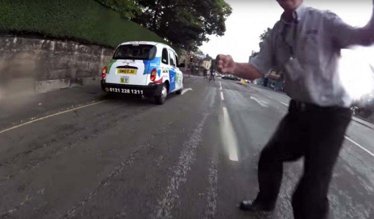 taxi driver assault to biker