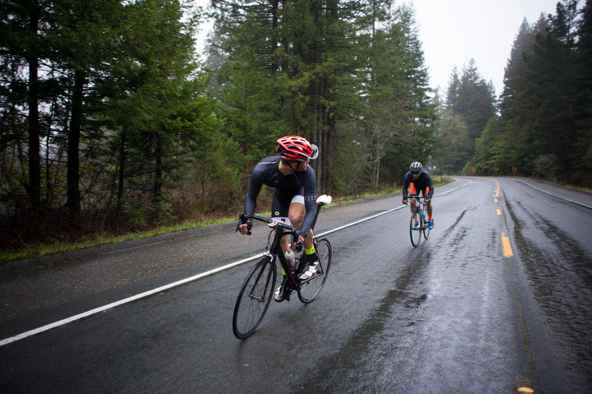 bike-handling-road-bike-wet-look-behind