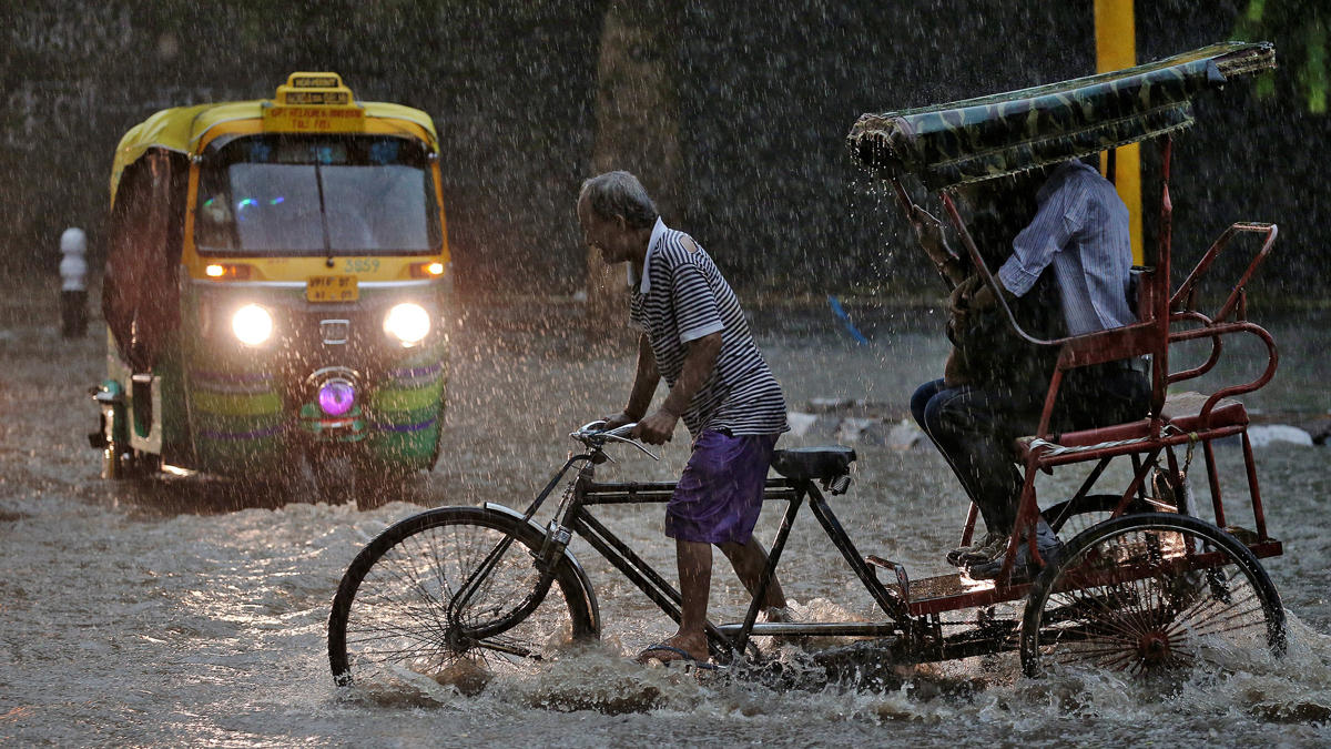 new delhi cycling carriage rain