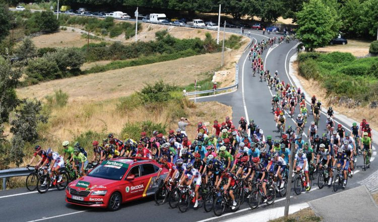 peloton with cars